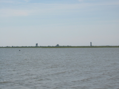 Two Wallops Island launch towers in the distance from the bay shore near Atlantic, Virginia