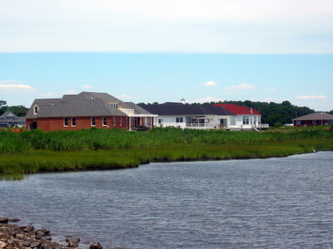 A handful of new houses along the bay shore with views of Wallops Island launch facilities, near Atlantic, Virginia