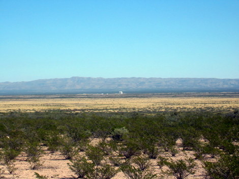 Landscape of the desert with the Blue Origin launch vacilities in the distance near Van Horn, Texas