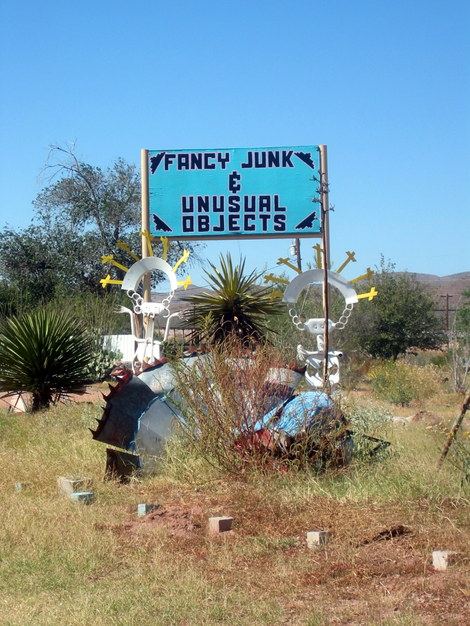 A photo of the sign for the Fancy Junk and Unusual Objects store in Van Horn, Texas