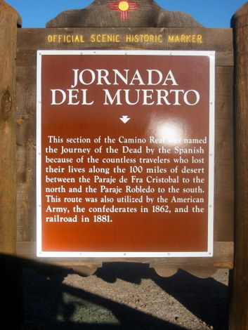Historical marker giving information on the Journey of the Dead in the Camino Real near Truth or Consequences, New Mexico, and the site of Spaceport America